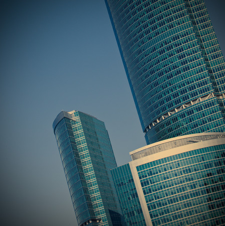 blue glass silhouettes of skyscrapers at morning photo