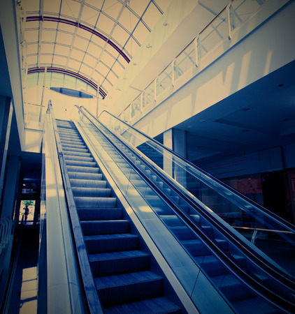 Escalator in modern building photo