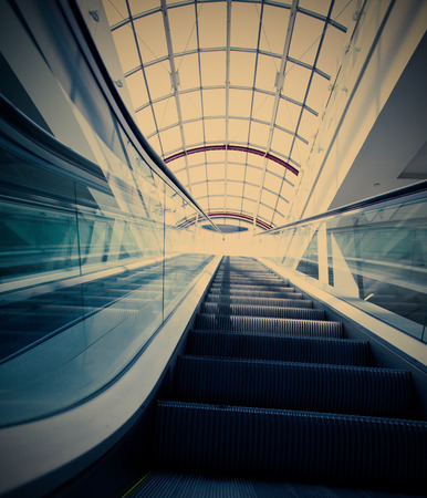 blue escalator in modern building photo