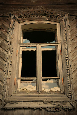 cottonwool: window of the old-time building with splinter glass, Ural culture, Russia Stock Photo
