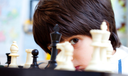 boy and chess, close-up, portrait photo