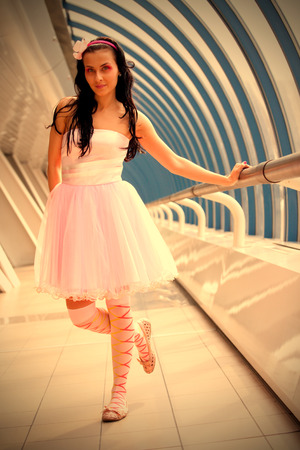 sightly: girl in a pink dress in the glass gallery Stock Photo