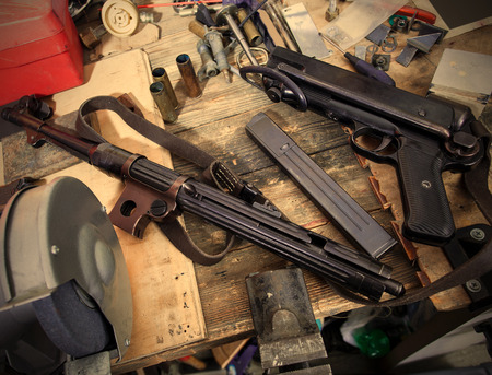 disassembled submachine gun MP-38. Gun locksmith workshop.