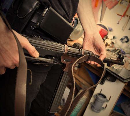 MP38 in the hands of a master restorer in the interior locksmith gunsmith. Stock Photo