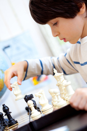 logical: boy playing a game of chess, the development of logical thinking