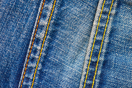 stitches: two stitches on jeans, close-up