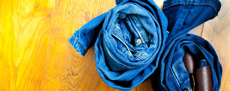 trousers: blue jeans trousers rolls, close up