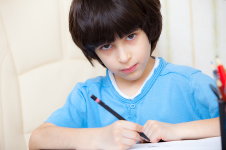 spaniard: schoolboy doing homework, portrait