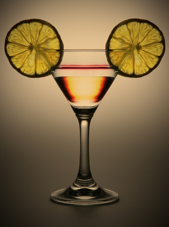 double glass: double alcoholic cocktail in tall wine glass with two transparent segment of the lemon, instagram image style Stock Photo
