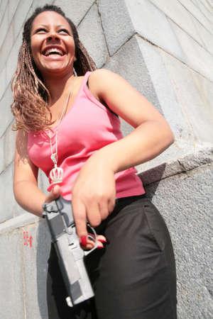 tanktop: laughing gangster-woman in tanktop with big black gun
