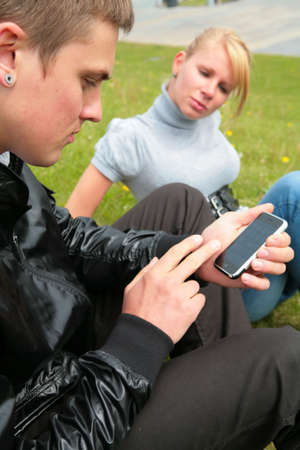 conceived: young man keeps in hand computer device und girl was conceived