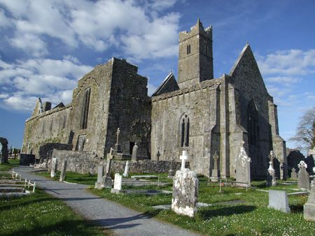 quin: View of ruins of Quin abbey in the village of Quin, county Clare, Ireland Stock Photo