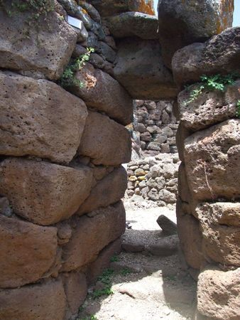 stoneage: Entrance to historic stone age building in the mountains in Sardinia Stock Photo