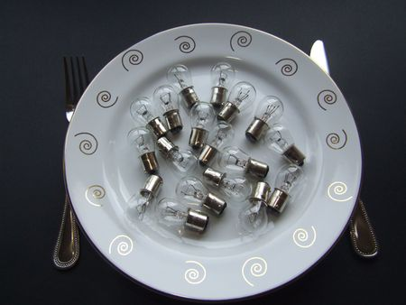 nonfat: Light dinner showing and number of small bulbs on a plate with knife and fork