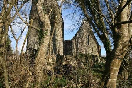 Ruins of old church and round tower in old cemetery dating to the 10th century Stock Photo - 2845831