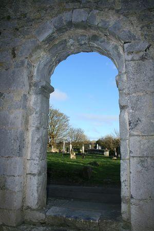 view through door: Cemetery view through door of historic ruined church in Ireland