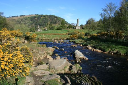monastic site: Beautiful stream with ruins of old Irish monastic site in the background