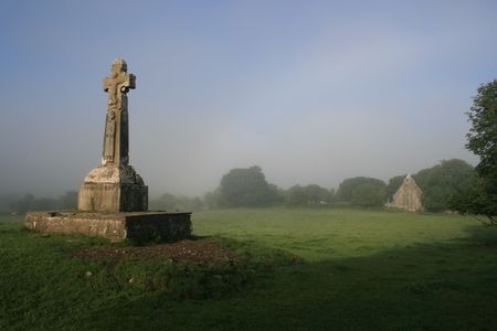 dea:  Early morning view of Celtic cross at Dysart o Dea county Clare Ireland dating to pre 10th century