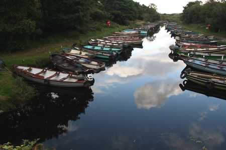 river county: Small fishing boats on scenic river near Killarney county Kerry, Ireland