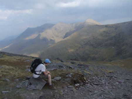 kerry: Hiker resting near Carrauntoohil summit Irelands highest mountain in county Kerry Stock Photo