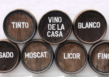 spanish house: Wine Barrels on a white wall Stock Photo
