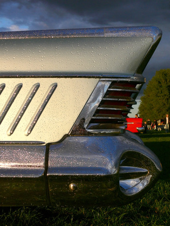 taillight: The rear fin and taillight of a 1950s classic american car covered in raindrops Stock Photo