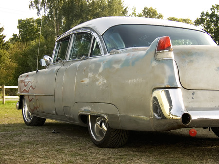 A Cool and beat up 1950s classic american car painted with red flames