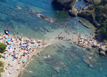 A mall strip of land,beach, almost join the small island of Isola Bella with the bigger island of Sicily
