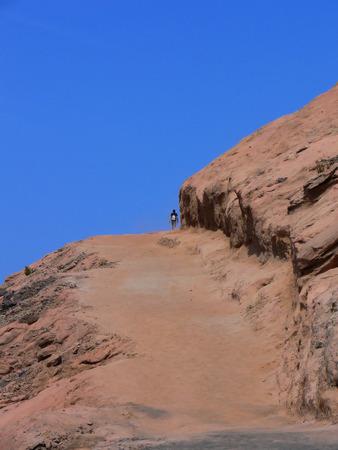 vulcano: A man climbing to the top of the vulcano on the island of Vulcano outside Sicily Italy