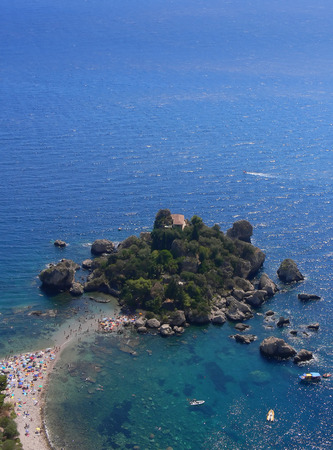 isola: The small idyllic and popular island of Isola Bella in Sicily Italy seen Taormina high above Stock Photo