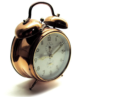 An older alarm clock showing the time of ten past nine Stock Photo - 1716572
