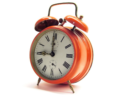 An older alarm clock showing the time of 9 o´clock Stock Photo