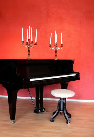 A grand piano and candelabras in an art galleri Stock Photo