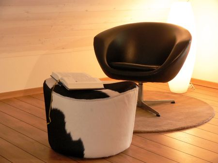 Reading chair and a cow stool