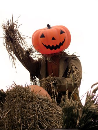 spectre: A smiling Halloween scarecrow waving at you