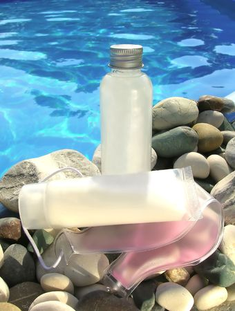 Spa products and stones by the pool