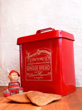 Homemade ginger bread, a tiny Santa and a ginger bread tin can