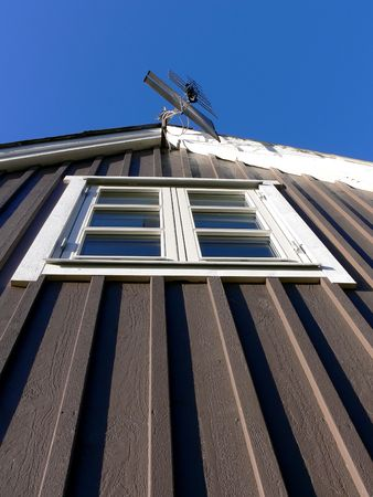 gable house: Closeup of a house gable with a TV antenna prepared for digital television Stock Photo