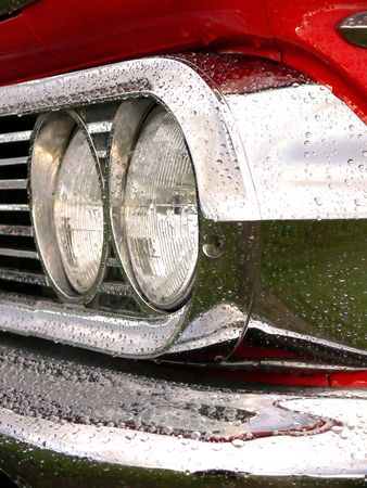 Closeup of headlights and chrome on an american classic car