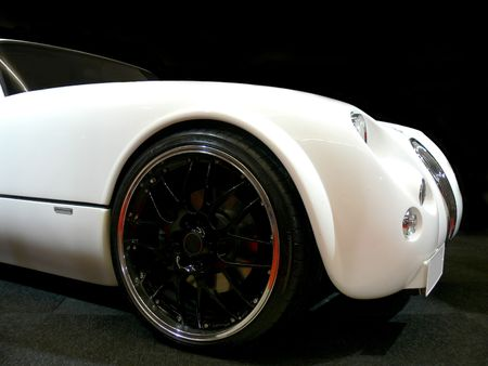 A white british open roadster
