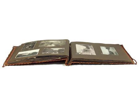 An old worn photo album laying open on white