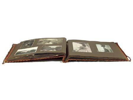 photo album page: An old worn photo album laying open on white