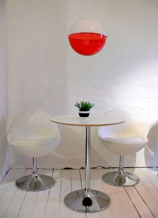 A white caf� with a table and two chairs