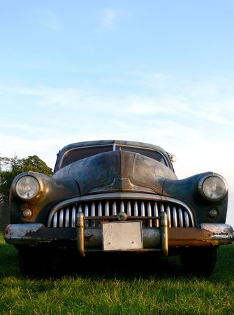 Old american vintage car in a rusty and un-polisched rat state photo
