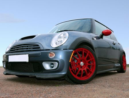 A small british race car parked on gravel Stock Photo