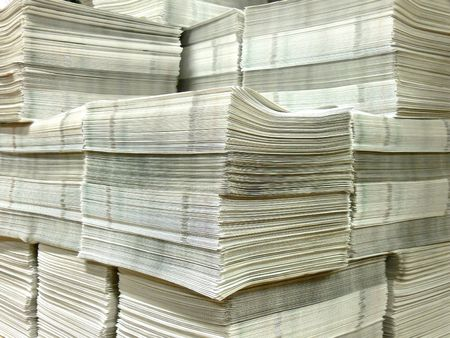 A pile of freshly printed newspaper waiting to be distributed Stock Photo