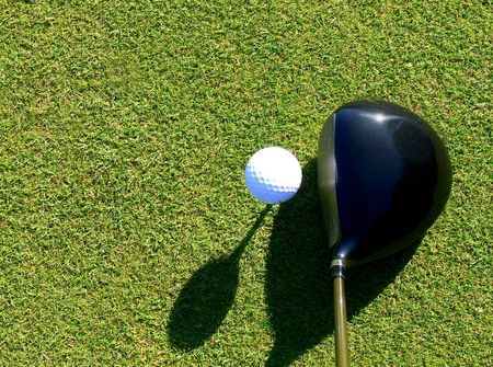 Close-up of ball and driver when preparing for a perfect drive Stock Photo - 4383543