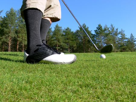 Close-up of a golfer pitching a golf ball towards the green Stock Photo - 4443248
