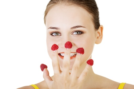 Smiling casual woman with raspberries, isolated on white.