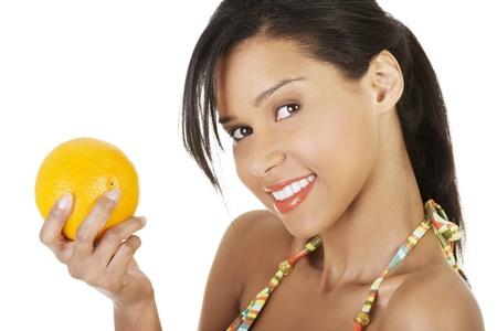 Happy summer woman in bikini with oranges  Isolated on white photo